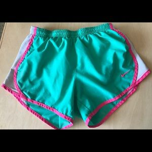 Mint and pink Nike track shorts